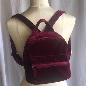 Mini red velvet backpack